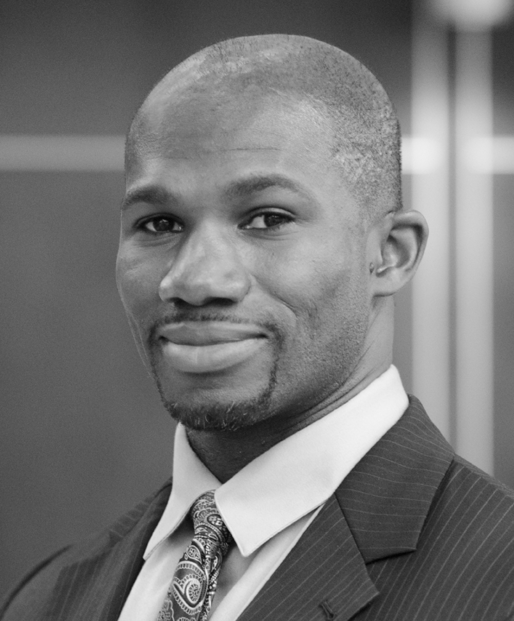 Black and white head shot of biomedical engineer Bolu Ajiboye