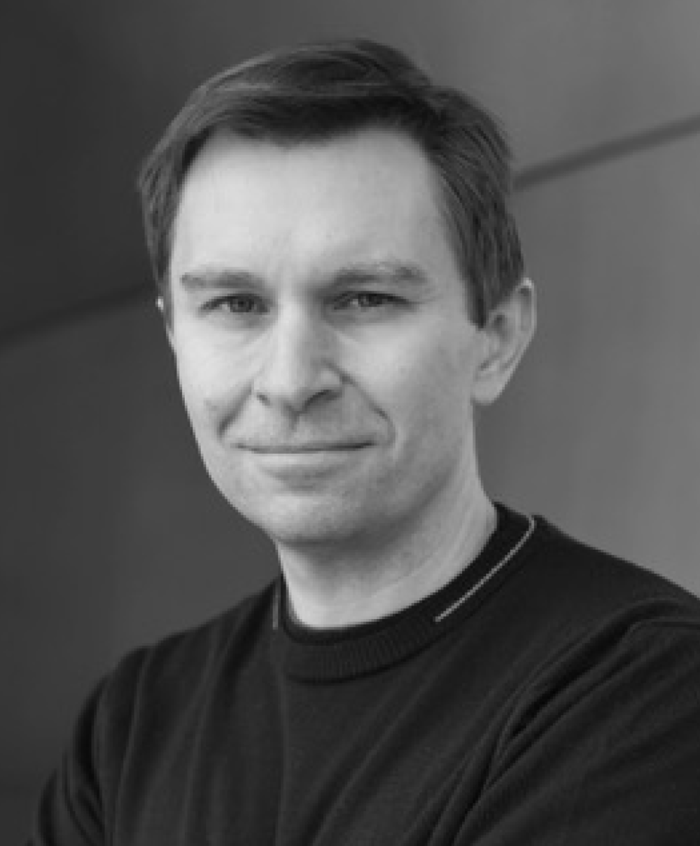 Black and white head shot of biologist and geneticist David Sinclair