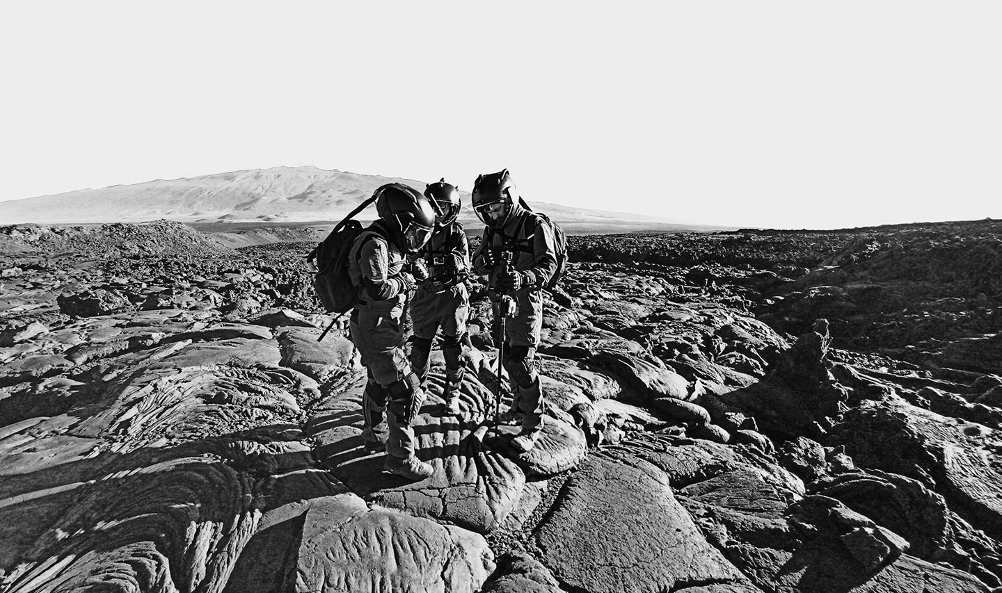 An image of 3 analogue astronauts exploring the lava fields of Hawaii.
