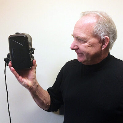 A candid picture of Walter holding a head mounted device.
